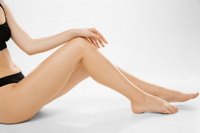 ysc-beautiful-female-legs-and-belly-isolated-on-white-background-beauty-cosmetics-spa-depilation-treatment-and-fitness-concept