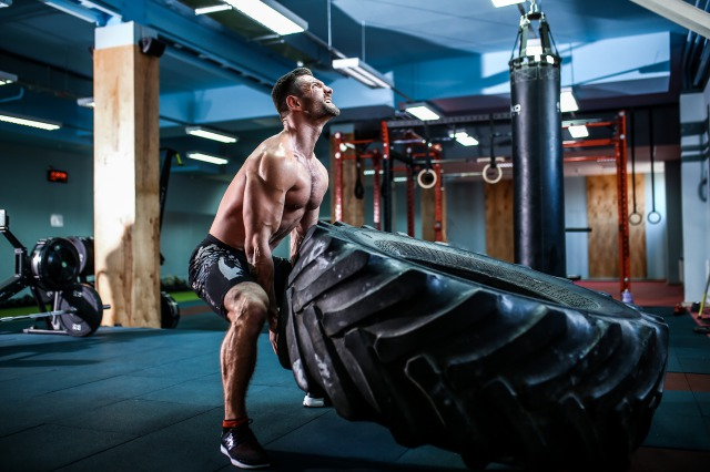 yscshirtless-man-flipping-heavy-tire