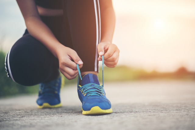 close-up-shoes-female-runner-tying-her-shoes-for-a-jogging-exercise